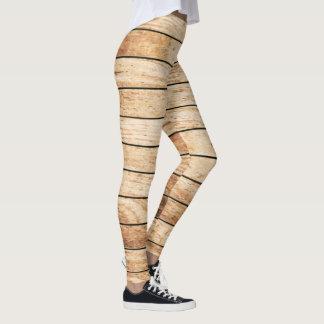 Leggings Contre le panneau en bois de grain