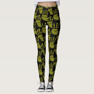 Leggings Motif noir et jaune d'impression de paume,