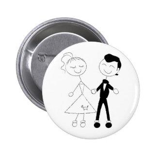 les années 1950 habillées vers le haut des couples badge avec épingle