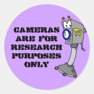 Les appareils-photo sont pour des recherches adhésif rond