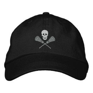 Les bâtons de crâne et de croix de lacrosse ont casquette brodée