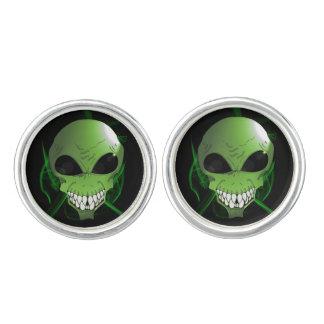 Les boutons de manchette ronds d'aliens verts,