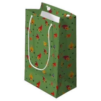 Les champignons avec le cadeau fait sur commande petit sac cadeau
