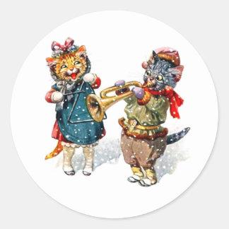 Les chats mignons jouent la trompette et la autocollants ronds