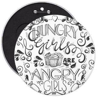 Les filles affamées sont bouton fâché de géant de badges