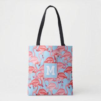 Les flamants roses lumineux sur le bleu | ajoutent sac