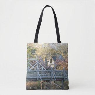Les fleurs de cerisier de printemps portent le sac