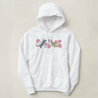 Les fleurs de libellules ont brodé le sweat -