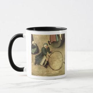 Les jeux des enfants : coordonnée d'un enfant avec mug