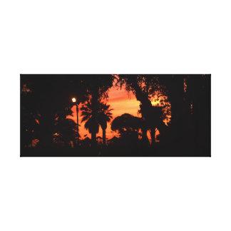 Les palmiers silhouettent au coucher du soleil toile