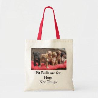 Les pitbulls sont pour des étreintes, pas voyous sacs fourre-tout