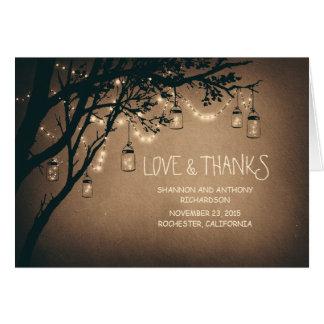 les pots de maçon et les lumières rustiques de cartes de vœux