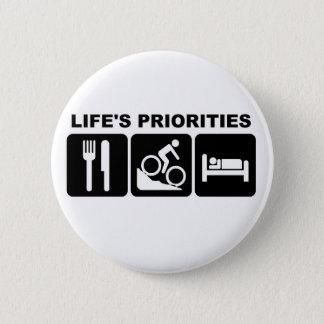 Les priorités de la vie, faisant du vélo pin's