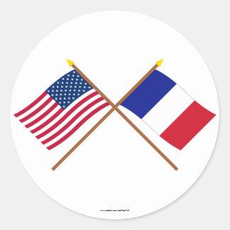 Les USA et drapeaux croisés par France Autocollant Rond