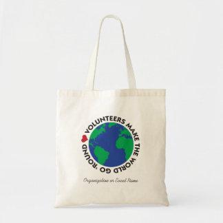 Les volontaires font le monde disparaître 'rond sacs fourre-tout