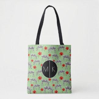 Les zèbres parmi des ketmies fleurit le monogramme tote bag