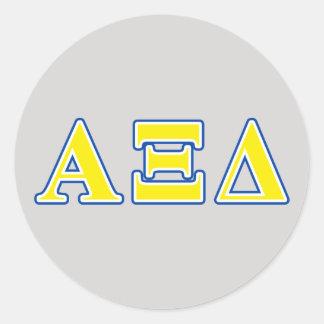Lettres jaunes et bleues de delta de l'alpha XI Sticker Rond