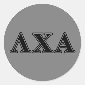 Lettres noires de Chi de lambda alpha Sticker Rond