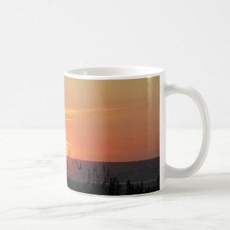 Lever de soleil externe de banques par l'avoine de mug