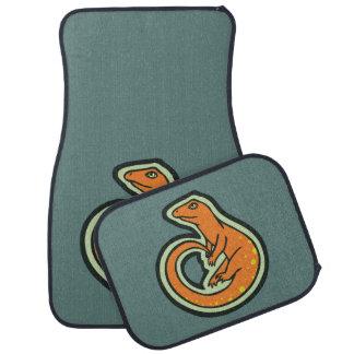 Lézard orange de longue queue avec des taches tapis de sol