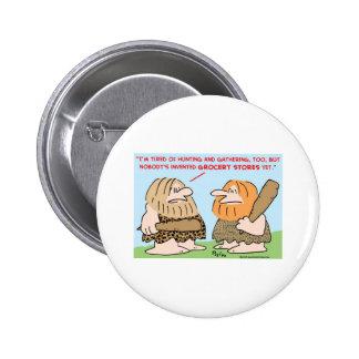 l'homme des cavernes a inventé des épiceries badge