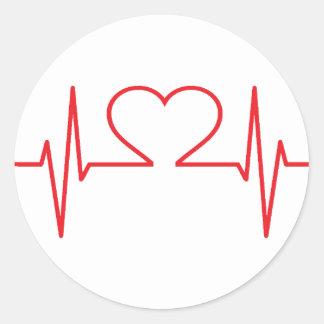 Ligne rouge de battement de coeur sticker rond