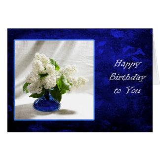 Lilas blancs sur le bleu carte de vœux