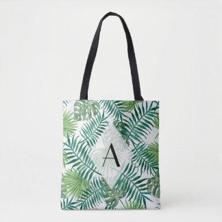 L'île tropicale laisse le sac fourre-tout à