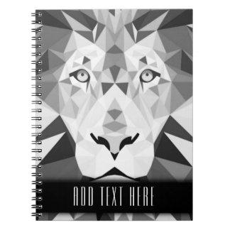 Lion géométrique argenté avec le texte fait sur carnet