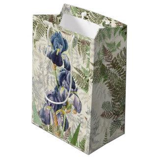 L'iris bleu botanique fleurit le sac de cadeau de