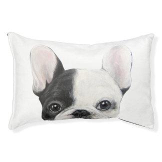 Lit noir et blanc de chien de bouledogue français