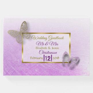 Livre de mariage de papillon de lavande et d'or