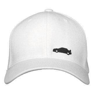 Logo blanc de noir de casquette de silhouette de