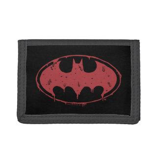 Logo de suintement de batte rouge de Batman |
