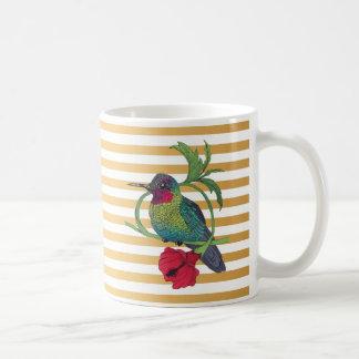 L'or d'oiseau de Colibri barre la tasse