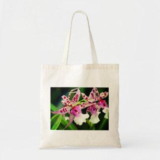 L'orchidée blanche rose fleurit le sac fourre-tout