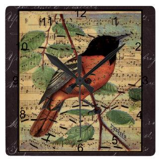 Loriot vintage sur la musique horloge carrée