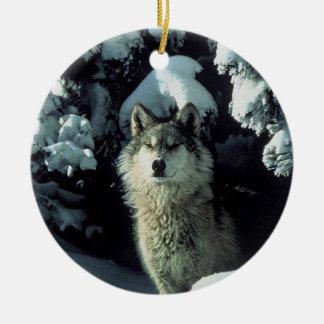 Loup dans la neige ornement rond en céramique