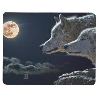 Loups de loup hurlant à la pleine lune la nuit carnet de poche