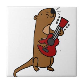 Loutre de mer drôle jouant la guitare petit carreau carré