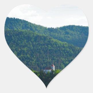 Lumière d'après-midi au-dessus d'église sticker cœur