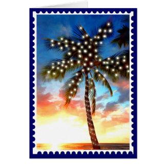 Lumières de palmier de vacances au coucher du sole carte de vœux