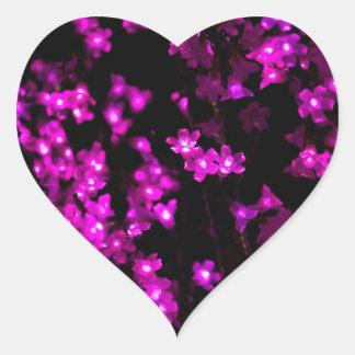 Lumières roses rougeoyantes de fleur sticker cœur