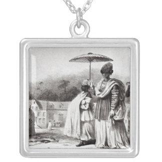 Madame portant l'enfant au baptême pendentif carré