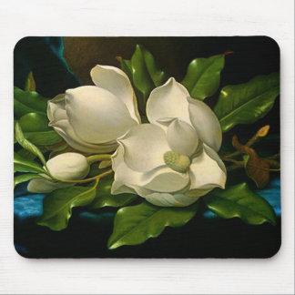 Magnolias géantes sur un tapis de souris bleu de t