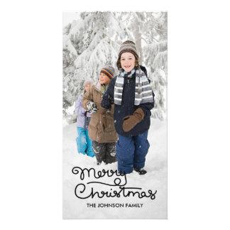 Main du carte photo   de vacances de Noël marquée