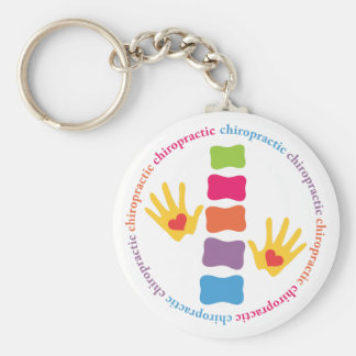 Mains de chiropractie et porte - clé d'épine porte-clé rond
