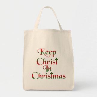 Maintenez le Christ dans le sac fourre-tout à