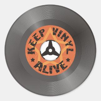 Maintenez le vinyle vivant sticker rond