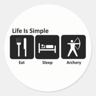 Mangez le tir à l'arc de sommeil sticker rond